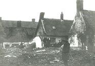 Afbraak huizen op Overleie in 1897